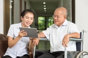 caregiver and senior man talking